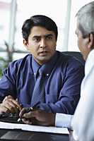 Indian business man talking to colleague - Asia Images Group