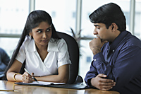 Indian woman and man discussing work - Asia Images Group