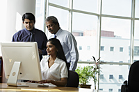 Indian business people looking at a computer - Asia Images Group