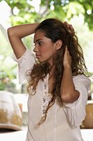 Profile of young woman holding hair - Asia Images Group