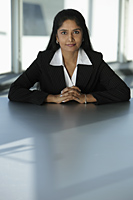 Indian business woman sitting at table - Asia Images Group