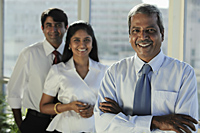 Three Indian business people smiling together - Asia Images Group