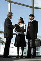 Three Indian people in business suits talking together - Asia Images Group