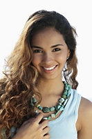 head shot of young woman smiling with long hair - Asia Images Group