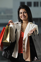 woman holding shopping bags and smiling - Asia Images Group