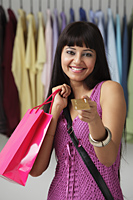 woman holding shopping bag and credit card - Asia Images Group