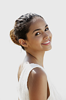 head shot of young woman smiling at camera - Asia Images Group