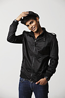 young man smiling wearing a hat - Asia Images Group