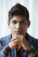 head shot of young man looking at camera - Asia Images Group