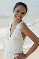 smiling woman wearing white at the beach - Asia Images Group