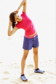 Young woman at the beach, exercising - Asia Images Group