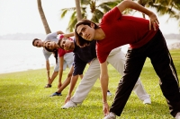 Young adults doing stretching exercises - Asia Images Group