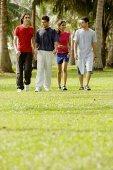 Young adults walking in park - Asia Images Group