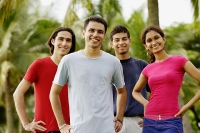 Young adults standing in park, looking at camera - Asia Images Group