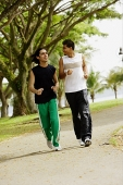 Young men jogging in park - Asia Images Group