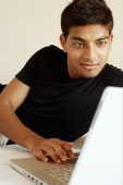 Man using laptop - Asia Images Group
