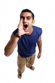 Young man looking up at camera, shouting - Asia Images Group
