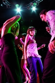 Young adults dancing in club - Asia Images Group