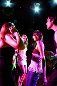 Young adults partying in club - Asia Images Group