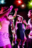 Young adults in club, dancing - Asia Images Group