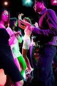 Young adults in club dancing face to face - Asia Images Group