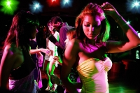 People dancing in club - Asia Images Group
