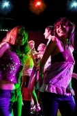 People dancing in night club - Asia Images Group