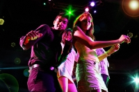 Couples dancing in club, looking at camera - Asia Images Group