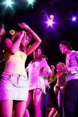 Adults dancing in club - Asia Images Group