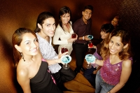 Young adults holding drinks, looking at camera - Asia Images Group