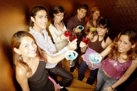 Young adults raising drinks to camera - Asia Images Group