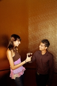 Couple toasting with drinks - Asia Images Group