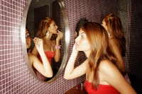 Two women in public restroom, applying make-up - Asia Images Group