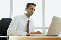 Male executive using laptop - Asia Images Group