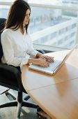 Female executive using laptop, high angle view - Asia Images Group