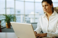 Businesswoman using laptop, portrait - Asia Images Group