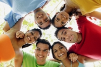 Group of young adults arms around each other, smiling - Asia Images Group