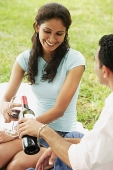 Couple having wine at park - Asia Images Group