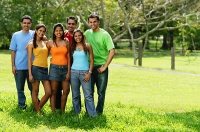 Group of young adults standing in park - Asia Images Group