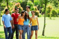 Young adults, walking in park - Asia Images Group