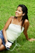 Young woman listening to music with headphones - Asia Images Group