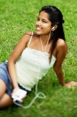 Young woman listening to music with headphones, portrait - Asia Images Group