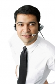 Executive wearing headset, looking at camera - Asia Images Group