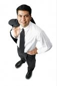 Businessman carrying jacket over shoulder, hand on hip - Asia Images Group