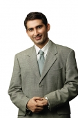 Businessman, looking at camera, portrait - Asia Images Group