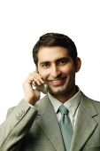 Businessman using mobile phone, facing camera - Asia Images Group