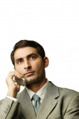Businessman using mobile phone, portrait - Asia Images Group