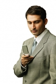 Businessman looking at mobile phone - Asia Images Group