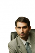 Businessman sitting, looking at camera - Asia Images Group