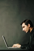 Man using laptop, profile - Asia Images Group